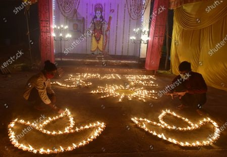 People light earthen lamps in a courtyard to celebrate the Bhoomi Pujan of Ayodhya's Ram Temple, at Ram Bhawan near Ram Lila Ground on August 5, 2020 in  Lucknow, India. The grand celebrations for the bhoomi pujan started at 8 am and Prime Minister Narendra Modi performed the Ayodhya Ram Mandir bhoomi pujan at the auspicious time of 12:40 pm.