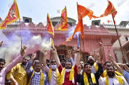 Activists of Bharatiya Janata Yuva Morcha (BJYM) hold flags while celebrating the temple foundation laying ceremony happening in Ayodhya on August 5, 2020 in Amritsar, India. The grand celebrations for the bhoomi pujan started at 8 am and Prime Minister Narendra Modi performed the Ayodhya Ram Mandir bhoomi pujan at the auspicious time of 12:40 pm.