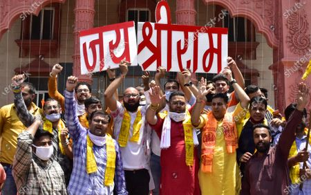 """Activists of Bharatiya Janata Yuva Morcha (BJYM) hold a placard reading """"Jai Sri Ram"""" while celebrating the temple foundation laying ceremony happening in Ayodhya on August 5, 2020 in Amritsar, India. The grand celebrations for the bhoomi pujan started at 8 am and Prime Minister Narendra Modi performed the Ayodhya Ram Mandir bhoomi pujan at the auspicious time of 12:40 pm."""