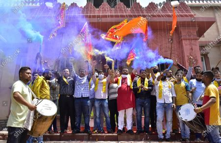 Activists of Bharatiya Janata Yuva Morcha (BJYM) react while celebrating the temple foundation laying ceremony happening in Ayodhya on August 5, 2020 in Amritsar, India. The grand celebrations for the bhoomi pujan started at 8 am and Prime Minister Narendra Modi performed the Ayodhya Ram Mandir bhoomi pujan at the auspicious time of 12:40 pm.