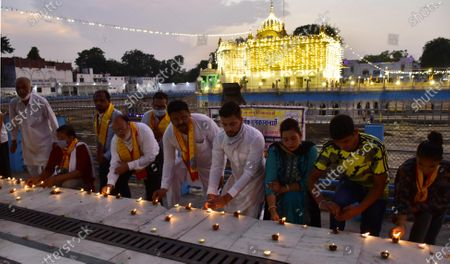 Devotees light earthen lamps at Durgiana Temple on the occasion of Bhoomi Pujan of Ayodhya's Ram Temple on August 5, 2020 in Amritsar, India. The grand celebrations for the bhoomi pujan started at 8 am and Prime Minister Narendra Modi performed the Ayodhya Ram Mandir bhoomi pujan at the auspicious time of 12:40 pm.