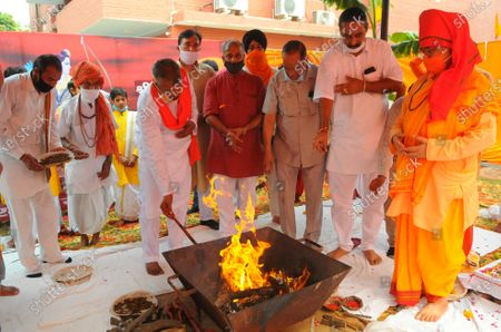Members of BJP Chandigarh organizing a mahayagya on the occasion of the foundation laying of the Ram Temple in Ayodhya, at BJP office KamlamSector 33 on August 5, 2020 in Chandigarh, India. The grand celebrations for the bhoomi pujan started at 8 am and Prime Minister Narendra Modi performed the Ayodhya Ram Mandir bhoomi pujan at the auspicious time of 12:40 pm.