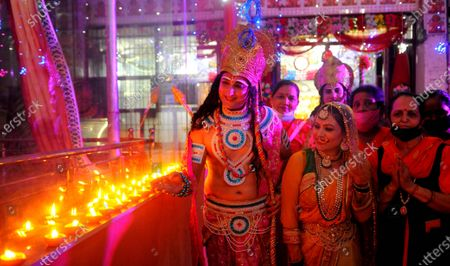 People dressed up as Lord Ram, Lord Lakshman and Sita Ma as they celebrate the Bhumi Pujan of Ayodhya's Ram Temple during a Nari Jagriti Manch organized by a temple  at Sector 40 on August 5, 2020 in Chandigarh, India. The grand celebrations for the bhoomi pujan started at 8 am and Prime Minister Narendra Modi performed the Ayodhya Ram Mandir bhoomi pujan at the auspicious time of 12:40 pm.