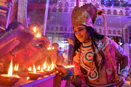 A man dressed up as Lord Ram interacts with devotees as they celebrate the Bhumi Pujan of Ayodhya's Ram Temple during a Nari Jagriti Manch organised by a temple  at Sector 40 on August 5, 2020 in Chandigarh, India. The grand celebrations for the bhoomi pujan started at 8 am and Prime Minister Narendra Modi performed the Ayodhya Ram Mandir bhoomi pujan at the auspicious time of 12:40 pm.
