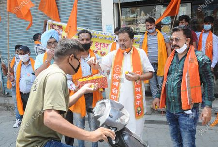 Members of Shiv Sena distribute sweets on the occasion of the Bhoomi Pujan in Ayodhya of the Ram Temple, at Arya Samaj on August 5, 2020 in Patiala, India. The grand celebrations for the bhoomi pujan started at 8 am and Prime Minister Narendra Modi performed the Ayodhya Ram Mandir bhoomi pujan at the auspicious time of 12:40 pm.