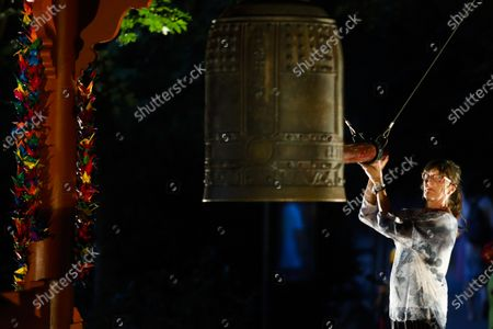 Woman controls the World Peace Bell on the eve of the 75th anniversary of the atomic bombing on Hiroshima, at a memorial in Berlin, Germany