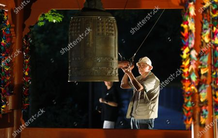 Man controls the World Peace Bell on the eve of the 75th anniversary of the atomic bombing on Hiroshima, at a memorial in Berlin, Germany
