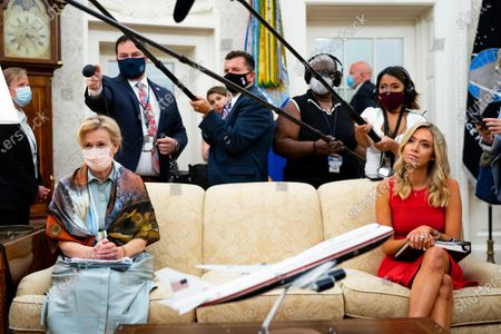 Dr. Deborah Birx, White House coronavirus response coordinator, left and White House Press Secretary Kayleigh McEnany, right, look on as President Donald Trump makes remarks as he meets with Arizona's Governor Doug Ducey in the Oval Office, at the White House in Washington, DC, USA, 05 August 2020.