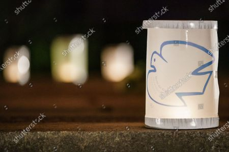 A lantern with a peace dove on it is illuminated on the occasion of the 75th anniversary of the Hiroshima and Nagasaki bombing at the Volkspark Friedrichshain park in Berlin, Germany, 05 August 2020. On 06 August 2020, Japan will mark the 75th anniversary of the bombing of Hiroshima. In 1945, the United States dropped two nuclear bombs over the cities of Hiroshima and Nagasaki on 06 and 09 August respectively, killing more than 200,000 people. This year's annual commemoration events were either canceled or scaled-down amid the ongoing coronavirus pandemic.