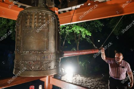 A man strikes the world peace bell on the occasion of the 75th anniversary of the Hiroshima and Nagasaki bombing at the Volkspark Friedrichshain park in Berlin, Germany, 05 August 2020. On 06 August 2020, Japan will mark the 75th anniversary of the bombing of Hiroshima. In 1945, the United States dropped two nuclear bombs over the cities of Hiroshima and Nagasaki on 06 and 09 August respectively, killing more than 200,000 people. This year's annual commemoration events were either canceled or scaled-down amid the ongoing coronavirus pandemic.