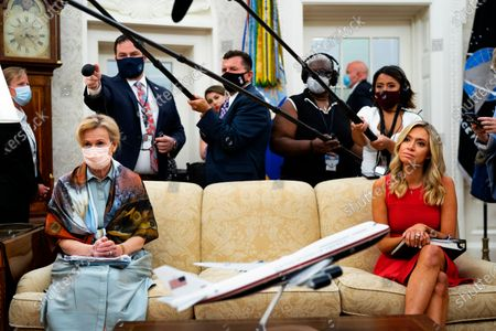 Ambassador Deborah L. Birx, M.D., White House Coronavirus Response Coordinator, left and White House Press Secretary Kayleigh McEnany, right, look on as President Donald Trump makes remarks as he meets with Arizona's Governor Doug Ducey in the Oval Office,.