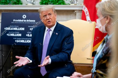 United States President Donald J. Trump makes remarks as he meets with Governor Doug Ducey (Republican of Arizona) in the Oval Office of the White House in Washington, DC,.