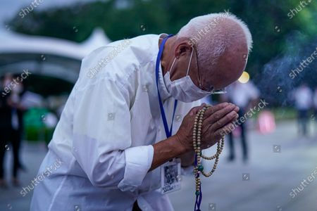 A survivor of the atomic bombing prays for the victims in front of a  cenotaph at Peace Memorial Park in Hiroshima, western Japan, early 06 August 2020.  On 06 August 2020 Japan marks the 75th anniversary of the bombing of Hiroshima. In 1945 the United States dropped two nuclear bombs over the cities of Hiroshima and Nagasaki on 06 and 09 August respectively, killing more than 200,000 people. This year's annual commemoration events were either canceled or scaled down amid the ongoing coronavirus pandemic.