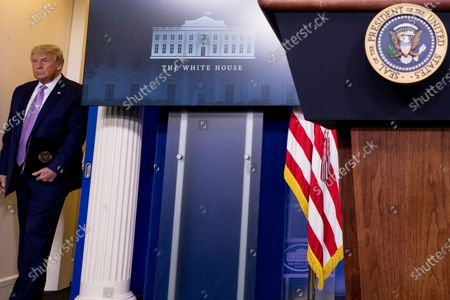 President Donald Trump arrives for a briefing with reporters in the James Brady Press Briefing Room of the White House, in Washington