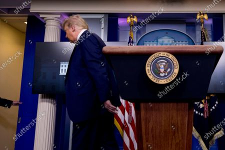 President Donald Trump leaves a briefing in the James Brady Press Briefing Room of the White House, in Washington