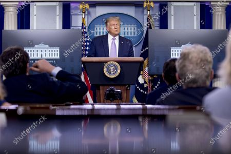 President Donald Trump pauses while speaking during a briefing with reporters in the James Brady Press Briefing Room of the White House, in Washington