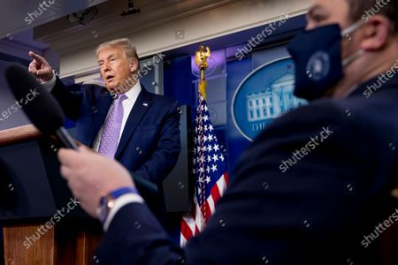 President Donald Trump calls on a reporter during a briefing with reporters in the James Brady Press Briefing Room of the White House, in Washington