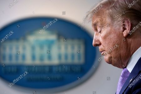US President Donald J. Trump pauses as he speaks during a news conference in the James S. Brady Press Briefing Room at the White House in Washington, DC, USA, 05 August 2020. President Trump discussed progress being made on negotiations over the next coronavirus relief package.
