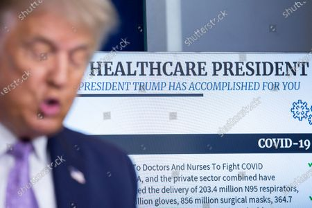 A display reading 'Healthcare President' is seen behind US President Donald J. Trump as he speaks during a news conference in the James S. Brady Press Briefing Room at the White House in Washington, DC, USA, 05 August 2020. President Trump discussed progress being made on negotiations over the next coronavirus relief package.