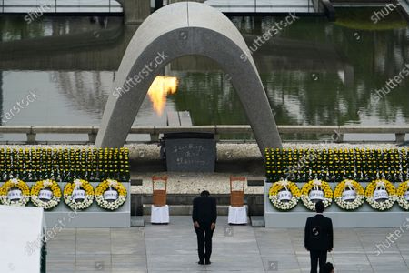 Japanese Prime Minister Shinzo Abe bows in front of Hiroshima Memorial Cenotaph during a ceremony to mark the 75th anniversary of the bombing at the Hiroshima Peace Memorial Park, in Hiroshima, western Japan