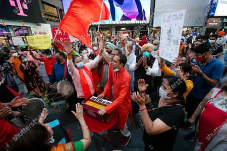 People gather in Times Square, in New York after the groundbreaking ceremony of a temple being built on disputed ground in India. Indian Prime Minister Narendra Modi participated in the groundbreaking for the Hindu temple Wednesday in the Indian city of Ayodhya
