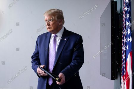 United States President Donald J. Trump arrives to a news conference in the James S. Brady Press Briefing Room at the White House in Washington D.C., U.S.,.