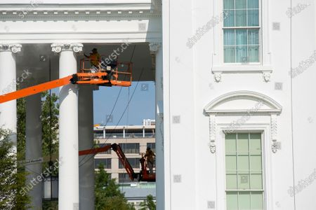 Stock Photo of Employees clean the outside of the North Portico of the White House in Washington D.C., U.S.,.