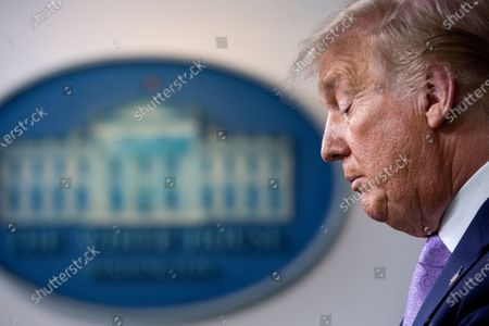 United States President Donald J. Trump pauses as he speaks during a news conference in the James S. Brady Press Briefing Room at the White House in Washington D.C., U.S.,.
