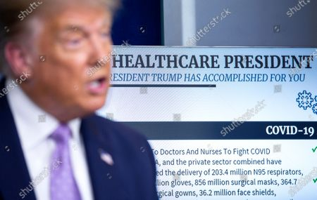 """A display reading """"Healthcare President"""" is seen behind United States President Donald J. Trump as he speaks during a news conference in the James S. Brady Press Briefing Room at the White House in Washington D.C., U.S.,."""