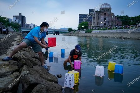 Volunteers release lanterns on the water of Motoyasu River near the Peace Memorial Park in Hiroshima, western Japan, 06 August 2020. Only a handful of representatives released lanterns on the water after the annual floating lantern event which attracts thousands of people has been canceled this year to avoid the spreading of the coronavirus disease (COVID-19) pandemic. On 06 August 2020 Japan marks the 75th anniversary of the bombing of Hiroshima. In 1945 the United States dropped two nuclear bombs over the cities of Hiroshima and Nagasaki on 06 and 09 August respectively, killing more than 200,000 people. This year's commemoration events were either canceled or scaled down amid the ongoing coronavirus pandemic.