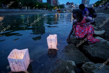 Seven-year-old Kenyan girl Joyce Makokha releases a lantern on the water of Motoyasu River near the Peace Memorial Park in Hiroshima, western Japan, 06 August 2020. Only a handful of representatives released lanterns on the water after the annual floating lantern event which attracts thousands of people has been canceled this year to avoid the spreading of the coronavirus disease (COVID-19) pandemic. On 06 August 2020 Japan marks the 75th anniversary of the bombing of Hiroshima. In 1945 the United States dropped two nuclear bombs over the cities of Hiroshima and Nagasaki on 06 and 09 August respectively, killing more than 200,000 people. This year's commemoration events were either canceled or scaled down amid the ongoing coronavirus pandemic.