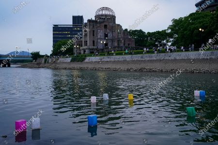 Only a few lanterns float on the water of Motoyas River near the Peace Memorial Park in Hiroshima, western Japan, 06 August 2020. Only a handful of representatives released lanterns on the water after the annual floating lantern event which attracts thousands of people has been canceled this year to avoid the spreading of the coronavirus disease (COVID-19) pandemic. On 06 August 2020 Japan marks the 75th anniversary of the bombing of Hiroshima. In 1945 the United States dropped two nuclear bombs over the cities of Hiroshima and Nagasaki on 06 and 09 August respectively, killing more than 200,000 people. This year's commemoration events were either canceled or scaled down amid the ongoing coronavirus pandemic.