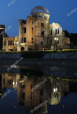The Atomic Bomb Dome is reflected on the River Motoyasu at the Peace Memorial Park in Hiroshima, western Japan, 05 August 2020, the eve of the 75th anniversary of the atomic bombing in 1945.