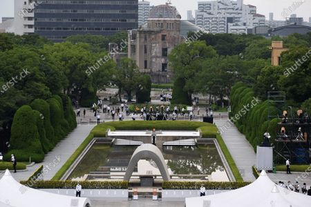 The memorial ceremony is held at the Peace Memorial Park within view of the Atomic Bomb Dome (C, Rear) in Hiroshima, western Japan, 06 August 2020. The ceremony was held to mark the 75th anniversary of the atomic bombing of Hiroshima in 1945.
