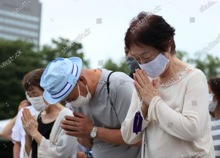 Residents offer prayers for victims of the 1945 atomic bombing during the memorial ceremony at the Peace Memorial Park in Hiroshima, western Japan, 06 August 2020. The ceremony was held to mark the 75th anniversary of the atomic bombing of Hiroshima in 1945.