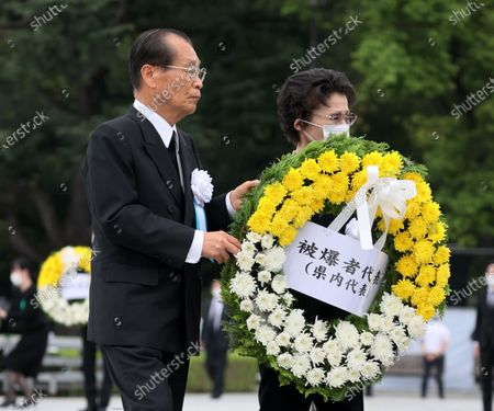 Atomic bombing survivors offer a wreath for victims of the 1945 atomic bombing during the memorial ceremony at the Peace Memorial Park in Hiroshima, western Japan, 06 August 2020. The ceremony was held to mark the 75th anniversary of the atomic bombing of Hiroshima in 1945.
