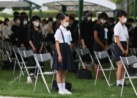 Young residents offer a minute of silent prayer for victims of the 1945 atomic bombing during the memorial ceremony at the Peace Memorial Park in Hiroshima, western Japan, 06 August 2020. The ceremony was held to mark the 75th anniversary of the atomic bombing of Hiroshima in 1945.