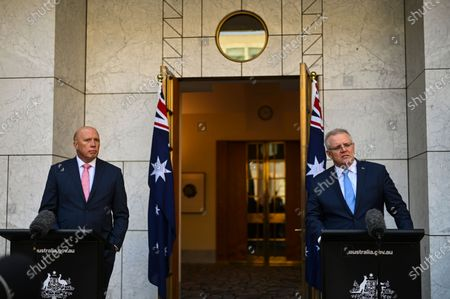 Australian Prime Minister Scott Morrison (R) speaks, accompanied by Minister for Home Affairs Peter Dutton (L), during a press conference at Parliament House in Canberra, Australia, 06 August 2020. Morrison announced an increase in federal spending on cybersecurity to 1.197 billion US dollars (1.664 billion Australian dollars) over the next decade.