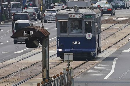 The No. 653 tram, which survived the atomic bomb, runs along the street near the Atomic Bomb Dome to commemorate the day of the U.S. first atomic bombing on the city in Hiroshima, Japan