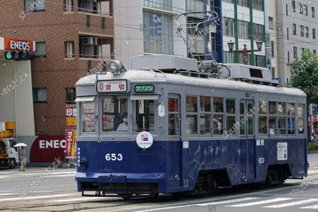The No. 653 tram, which survived the atomic bomb, runs along the street near the Atomic Bomb Dome to commemorate the 75th anniversary of the U.S. first atomic bombing on the city in Hiroshima, Japan