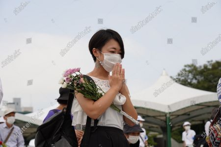 A woman prays while wearing a face mask at the Hiroshima Peace Memorial Ceremony. Hiroshima marks the 75th anniversary of the U.S. atomic bombing which killed about 150,000 people and destroyed the entire city during World War II.