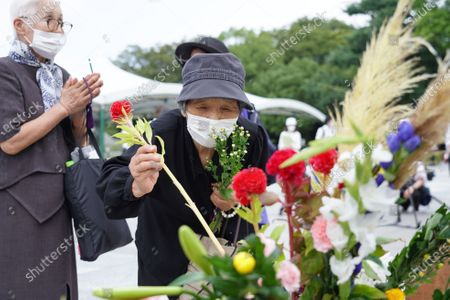 An elderly woman lays flowers at the Hiroshima Peace Memorial Ceremony. Hiroshima marks the 75th anniversary of the U.S. atomic bombing which killed about 150,000 people and destroyed the entire city during World War II.