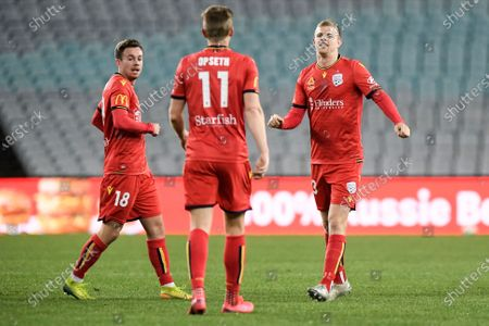 Stock Photo of Jordan Elsey of Adelaide United celebrates his goal with Kristian Opseth and Lachlan Brook of Adelaide United for 1-0 in the 13th minute; ANZ Stadium, Sydney, New South Wales, Australia; A League Football, Adelaide United versus Sydney FC.