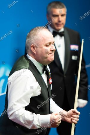 Stock Image of John Higgins celebrates after making a 147 at the Betfred World Championship for the first time. He becomes the seventh player to make a maximum break at the Crucible, and the first since 2012.