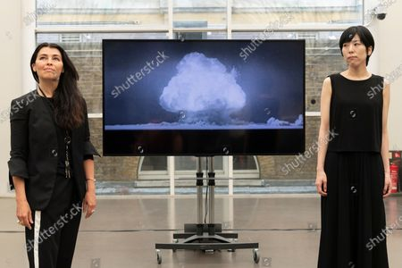 Stock Photo of Artist Es Devlin and artist Machiko Weston pose next to their new Imperial War Museum video commission 'I Saw The World End'. The work commemorates the 75th Anniversary of the bombings of Hiroshima and Nagasaki.
