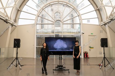 Stock Image of Artist Es Devlin and artist Machiko Weston pose next to their new Imperial War Museum video commission 'I Saw The World End'. The work commemorates the 75th Anniversary of the bombings of Hiroshima and Nagasaki.