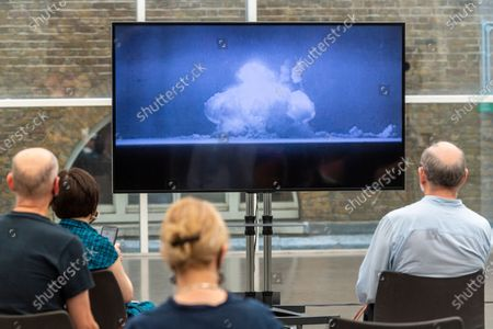 Stock Picture of Members of the press view the new Imperial War Museum video commission 'I Saw The World End' by artist Es Devlin and artist Machiko Weston. The work commemorates the 75th Anniversary of the bombings of Hiroshima and Nagasaki.