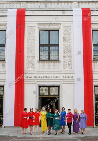 Poland's left-wing lawmakers dressed in rainbow colors to show support for the LGBT community before parliament building ahead of the ceremony of swearing in of President Andrzej Duda for a second term, in Warsaw, Poland, on . During his campaign Duda made statements hostile to LGBT community. Many of Poland's former leaders abstained from the ceremony to show disapproval for his first term policies