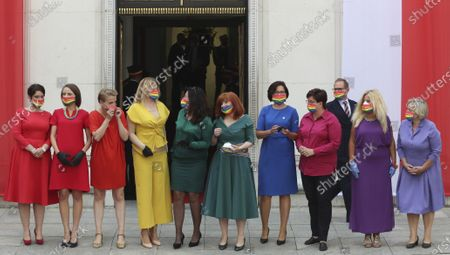 Poland's left-wing lawmakers dressed in rainbow colors to show support for the LGBT community outside the parliament building ahead of the swearing in ceremony of President Andrzej Duda for a second term, in Warsaw, Poland, . Duda has been sworn in for a second five-year term before parliament members. Duda's speech stressed the key role of the family in society and the need to protect it. The comments were seen as a repetition of his campaign message that was hostile to LGBT rights