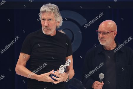 Roger Waters accepts O2 Silver Clef Award from Brian Eno on stage during The Nordoff Robbins O2 Silver Clef Awards 2018.